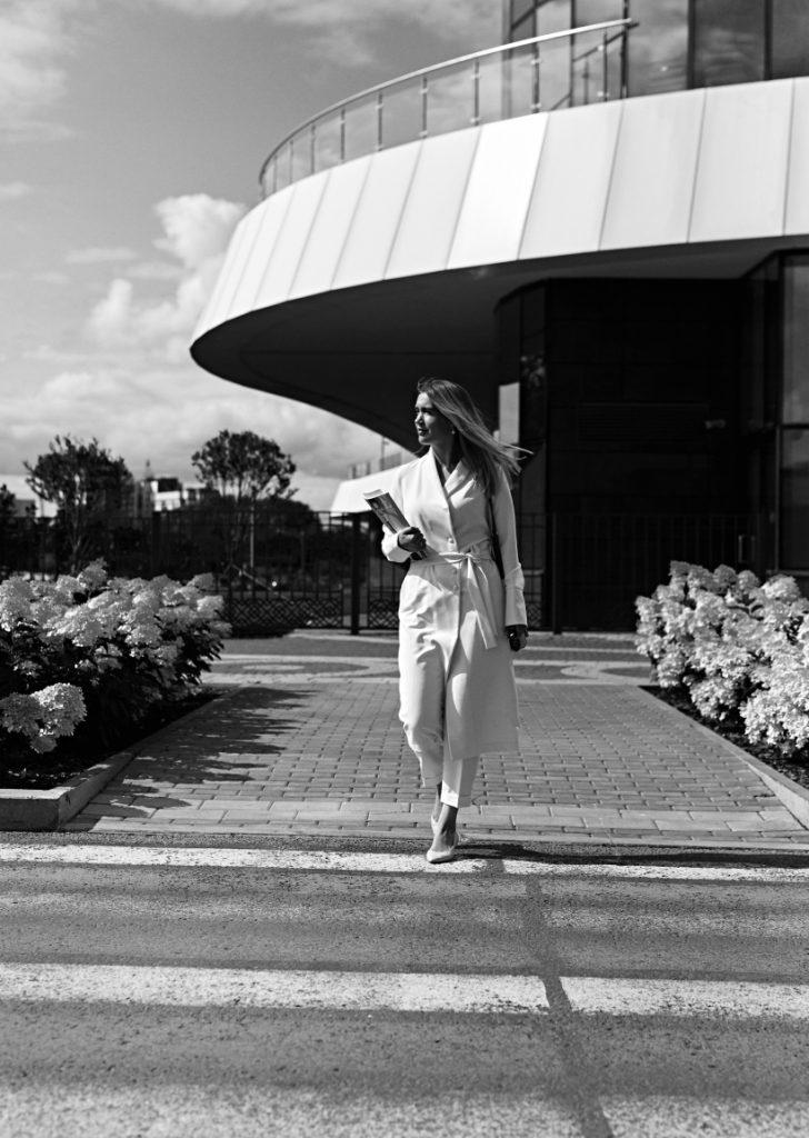 Female financial advisor walking to a meeting