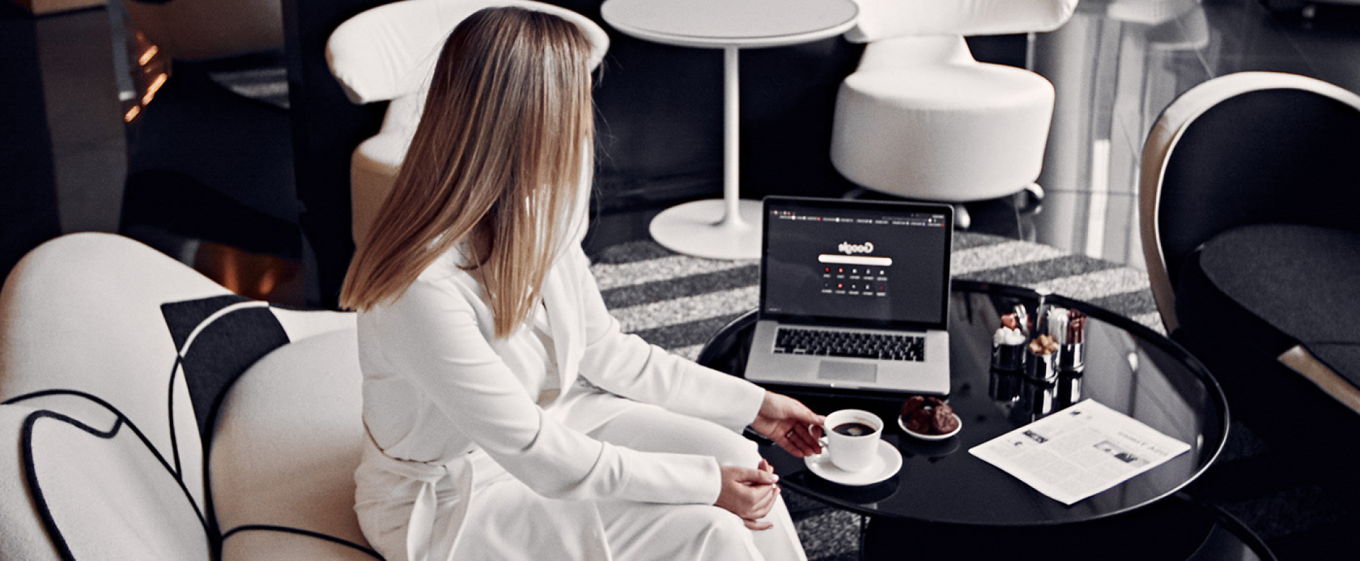 Female executive sitting at coffee table in a modern office